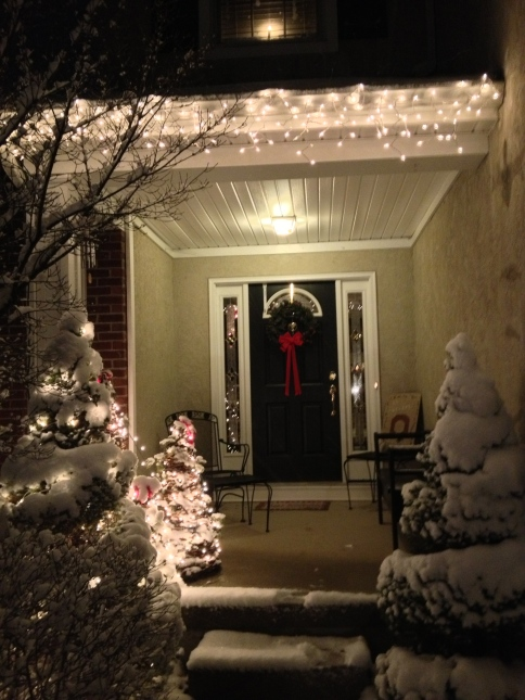 The front porch of the Brenner home, all decorated to accept Christmas guests.
