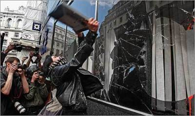 black bloc breaking window