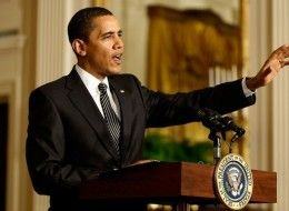 obama talking with arm stretched out